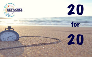 20 for 20 = Image of pocket watch in sand on beach